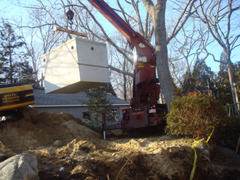 Dalpe Excavation placing a new septic tank in Falmouth Cape Cod